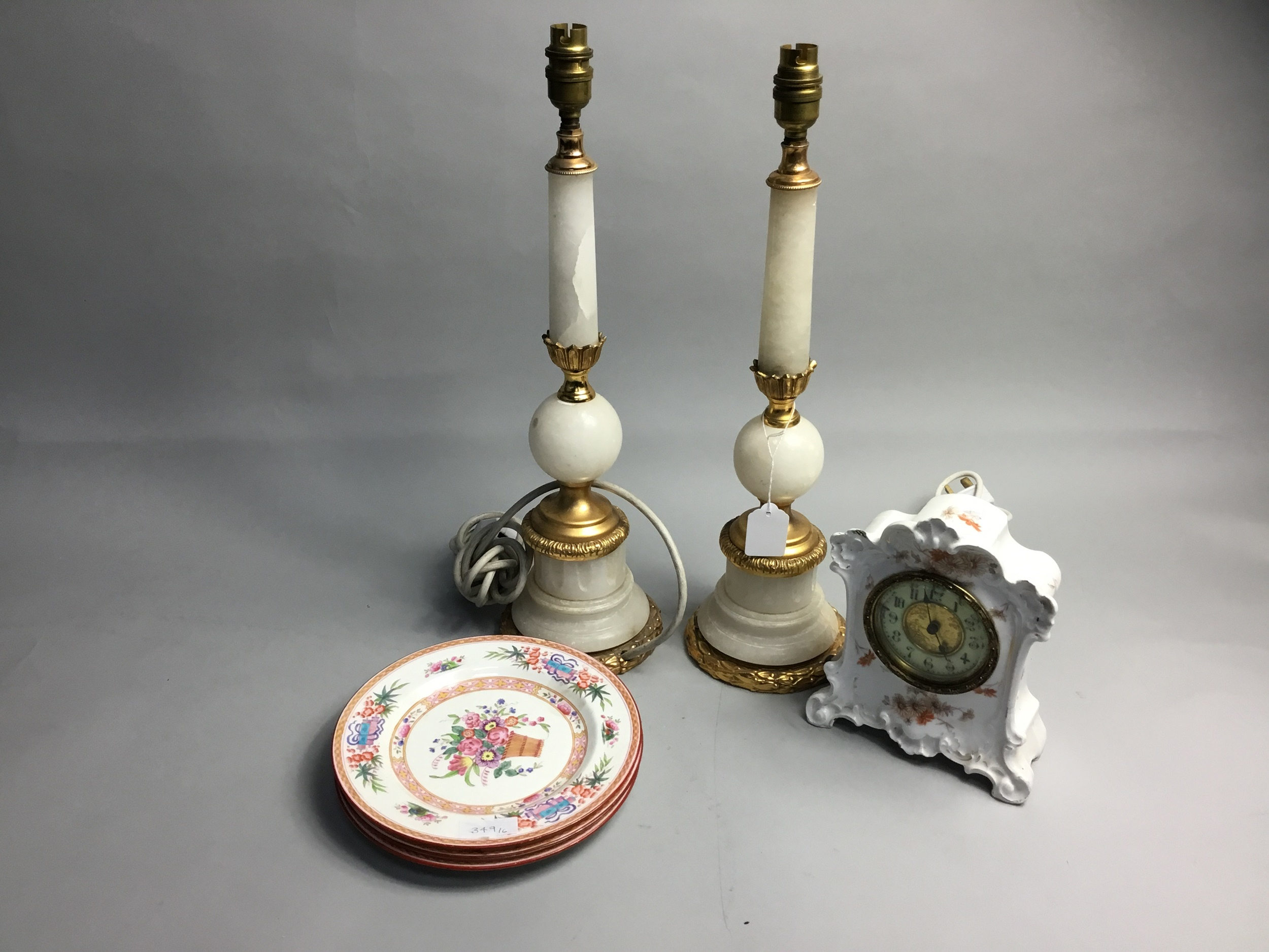 A PAIR OF ONYX AND BRASS TABLE LAMPS, CERAMICS CLOCK AND PLATES