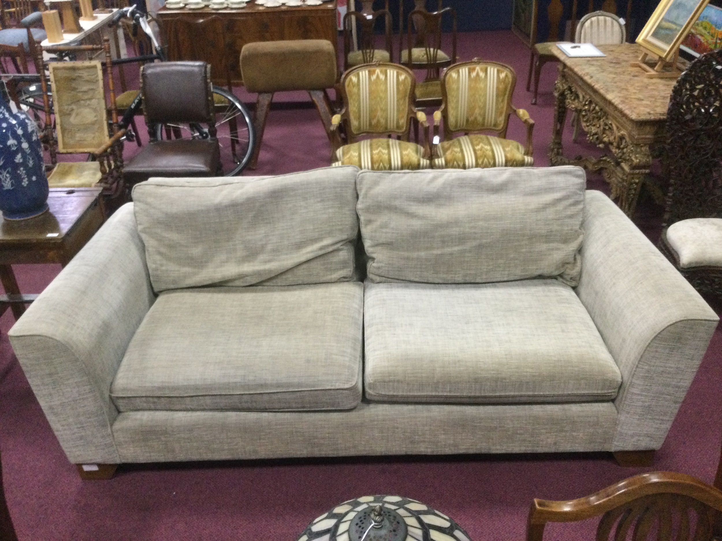 A MODERN UPHOLSTERED THREE SEATER SETTEE