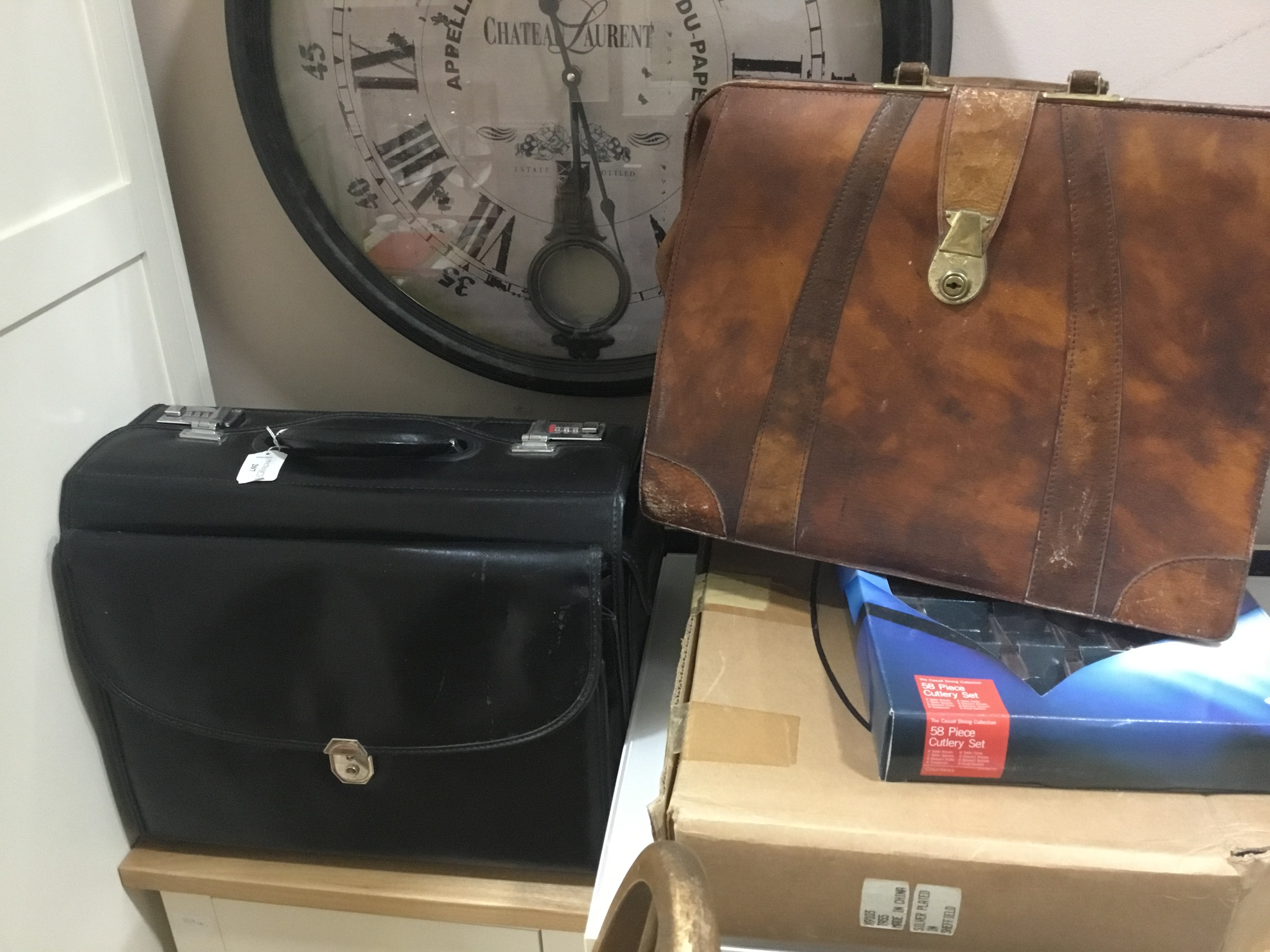 A VINTAGE LEATHER BRIEFCASE AND ANOTHER