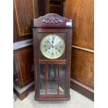 AN EARLY 20TH CENTURY MAHOGANY WALL CLOCK