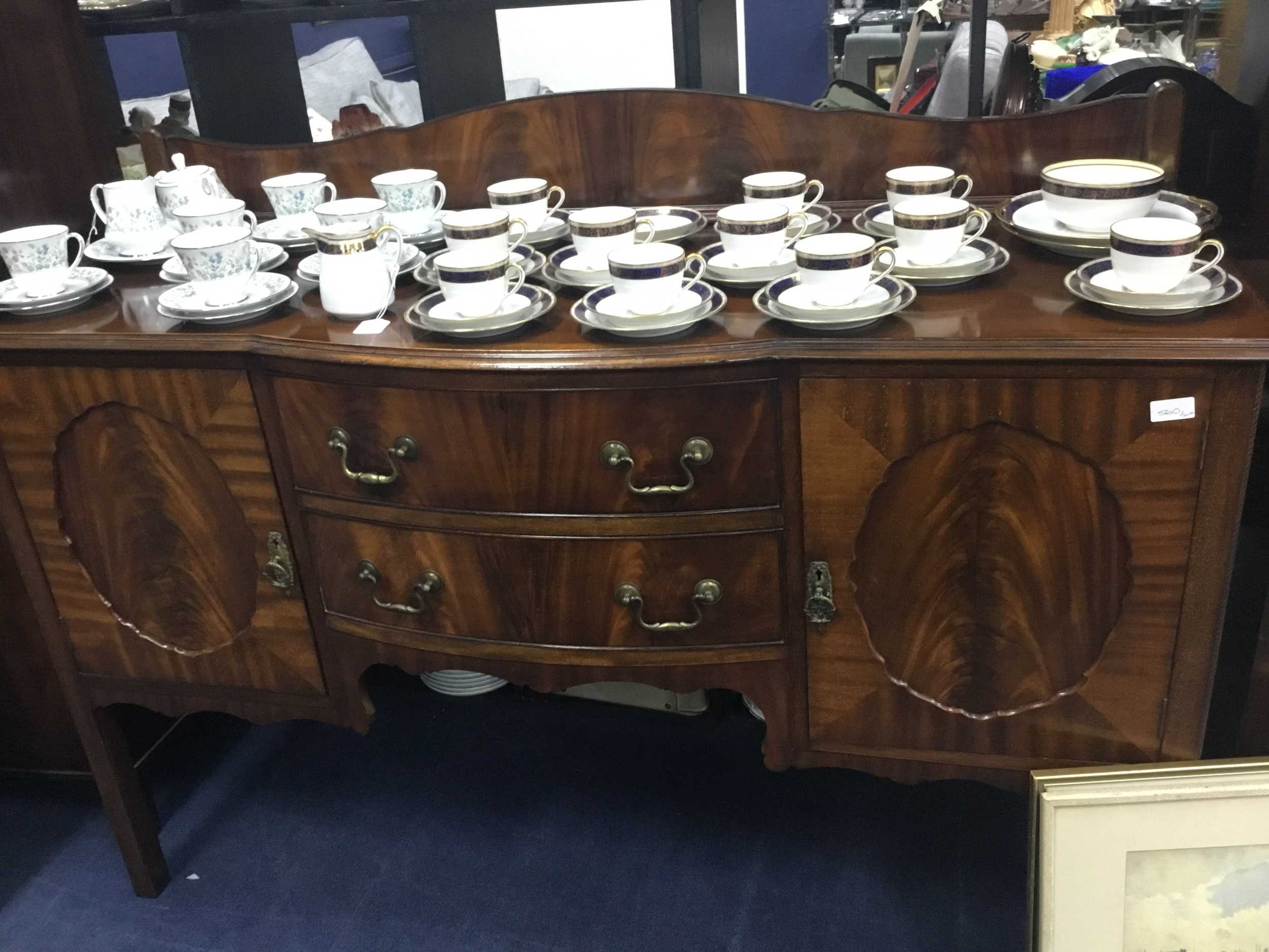 A MAHOGANY DINING SUITE