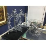 A LOT OF TWO WIREWORK PHOTOGRAPH FRAMES AND A WIREWORK BASKET