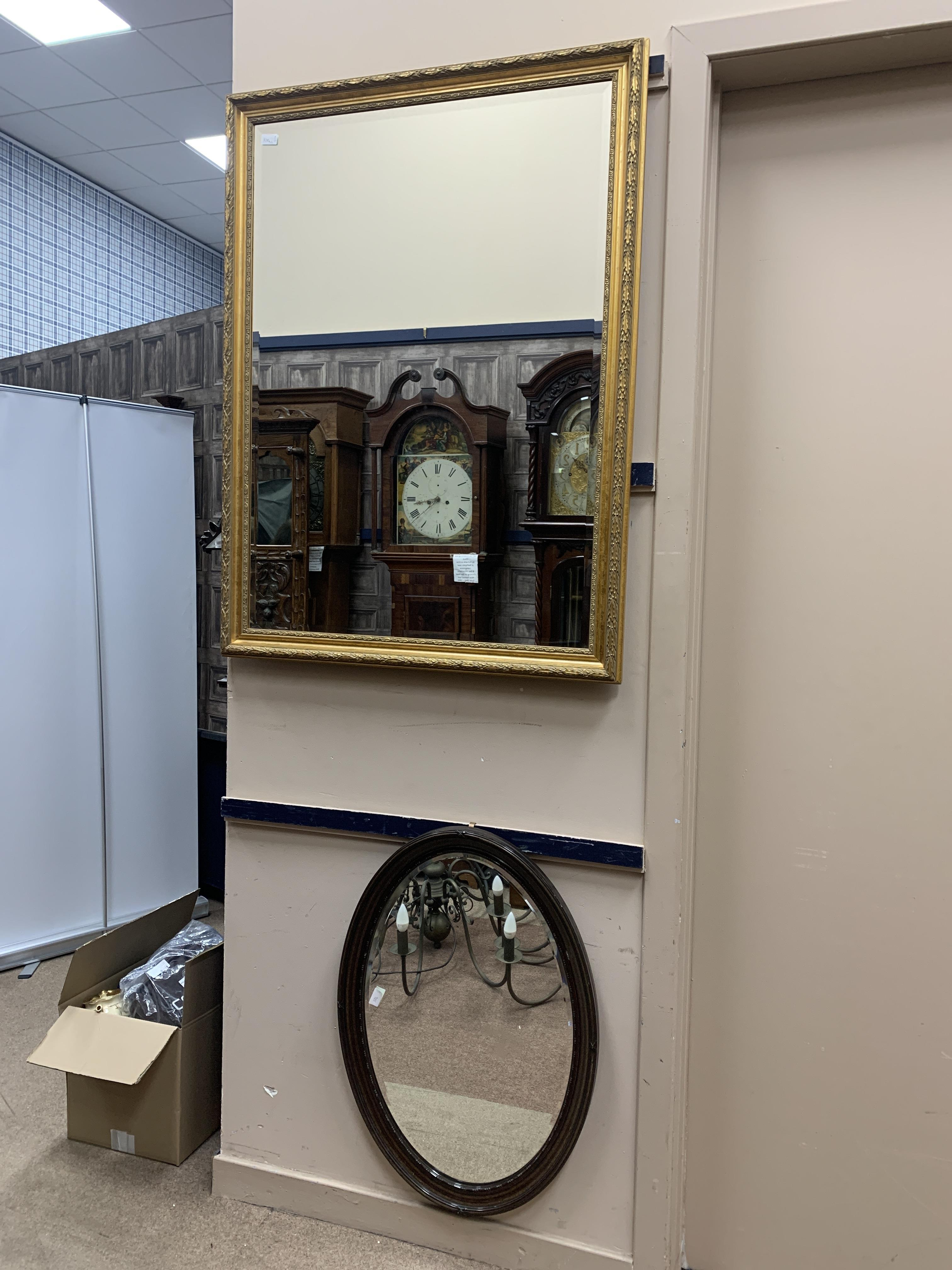 A GILT FRAMED OVER MANTEL MIRROR AND ANOTHER