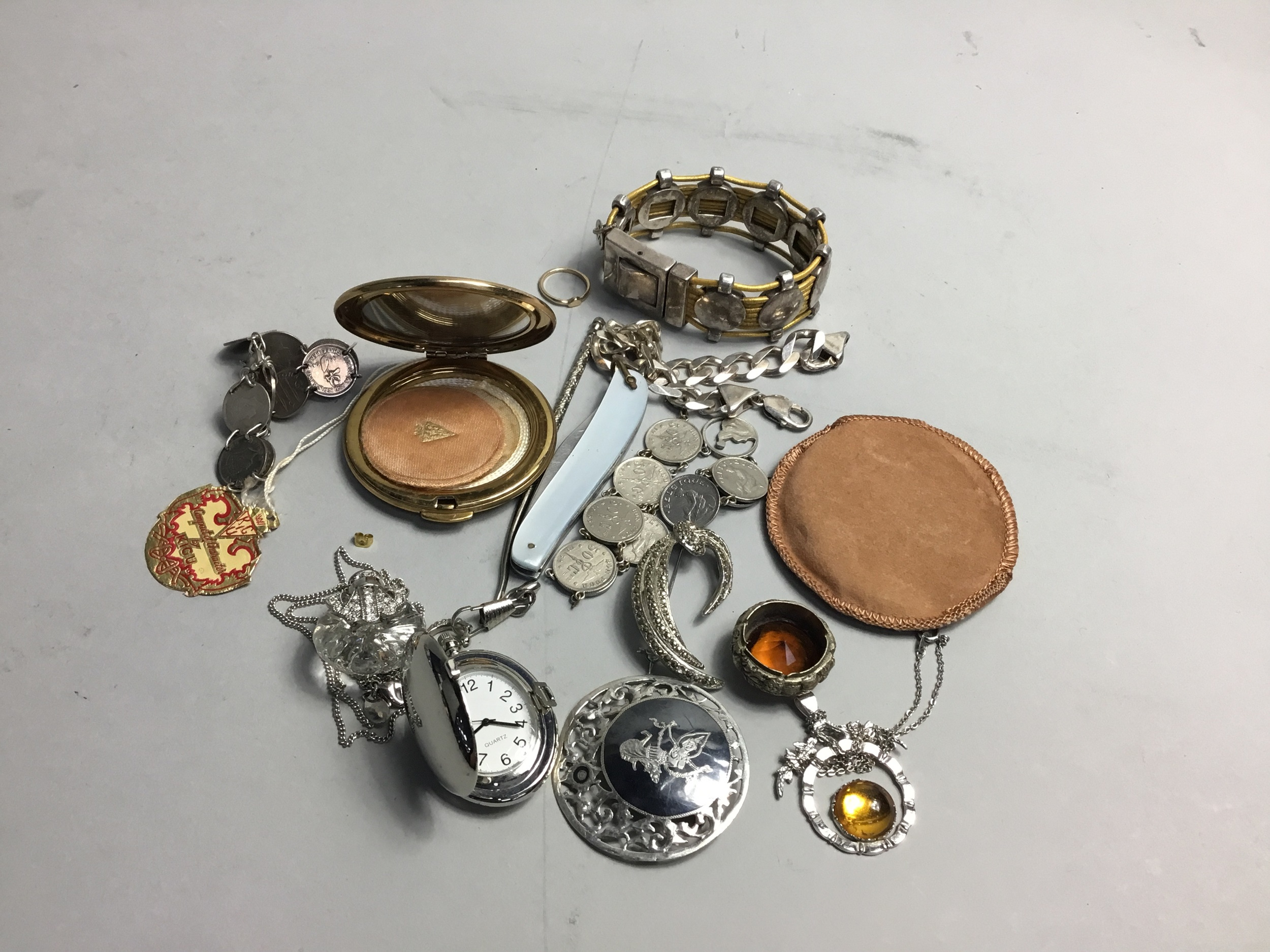 A SILVER BROOCH, OTHER BROOCHES, BRACELETS AND A PENDANT