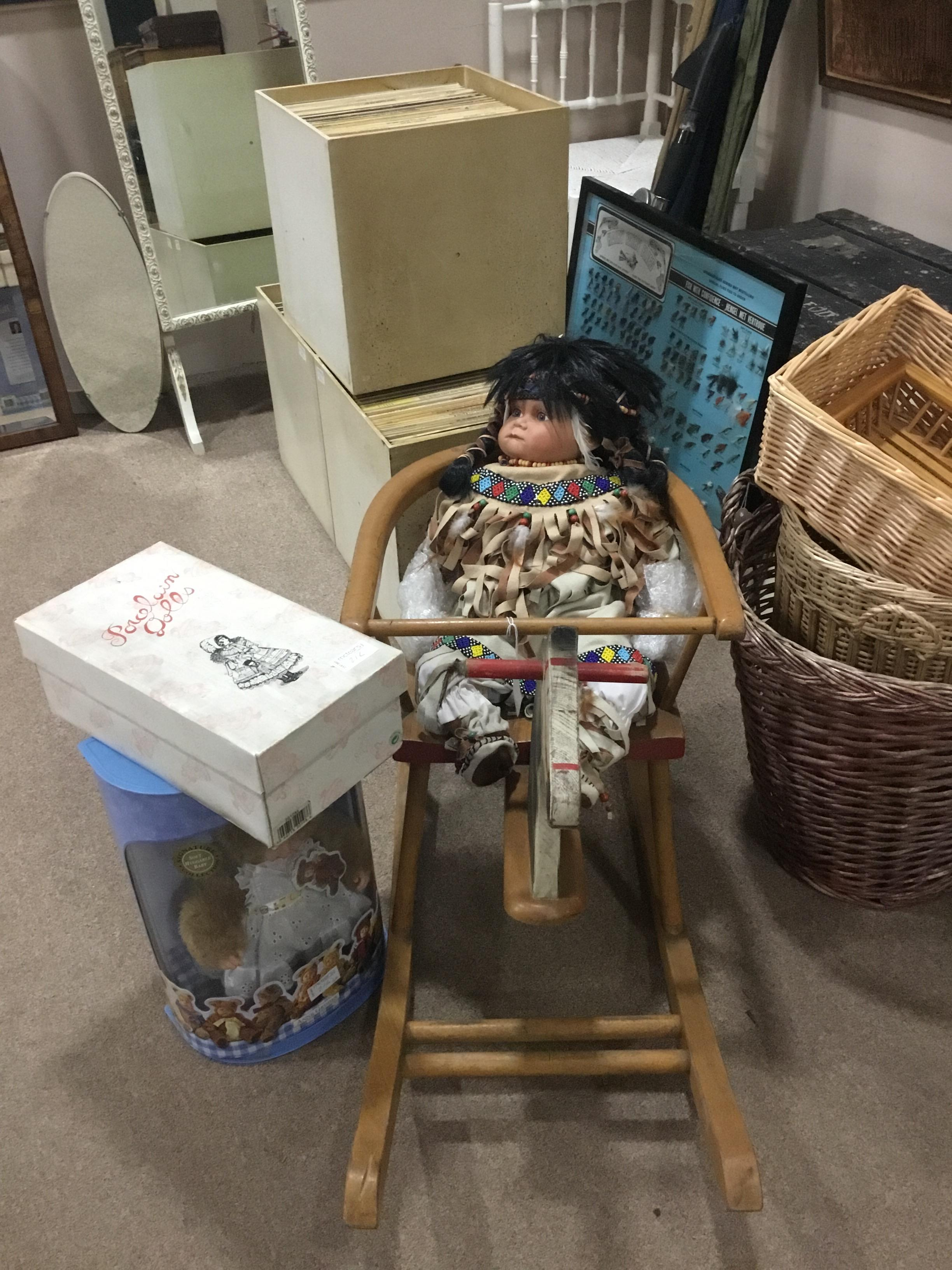 A MID 20TH CENTURY CHILD'S TOY ROCKER AND THREE DOLLS