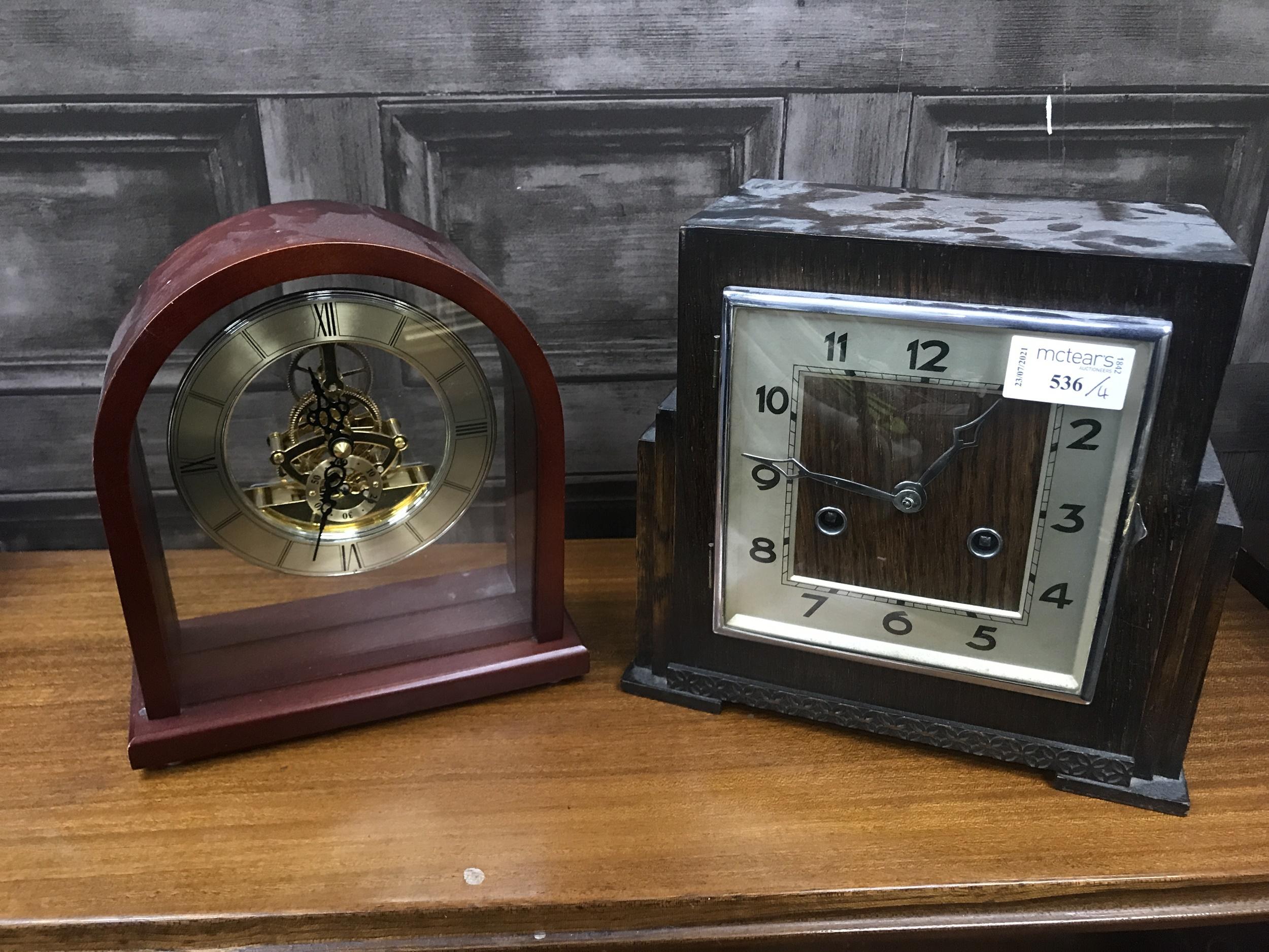 AN OAK ART DECO STYLE MANTEL CLOCK AND THREE OTHER CLOCKS