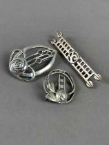 A COLLECTION OF SILVER BROOCHES AND PENDANTS