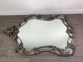 A LARGE SILVERED ROCOCO STYLE MIRROR