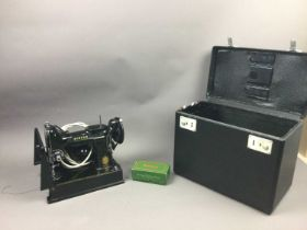 A SINGER 221K SEWING MACHINE AND A SEWING BOX