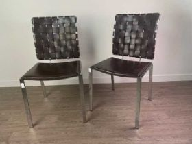 A SET OF FOUR MODERNIST LEATHER AND CHROMED CHAIRS BY COACH HOUSE FURNITURE