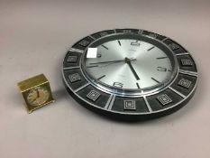 A ZENITH BRASS ALARM CLOCK ALONG WITH A WALL CLOCK