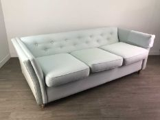 A MODERN UPHOLSTERED FOUR SEAT SOFA