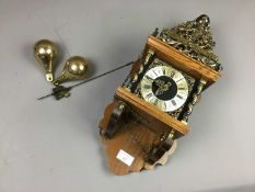 A REPRODUCTION BRASS AND OAK WALL CLOCK