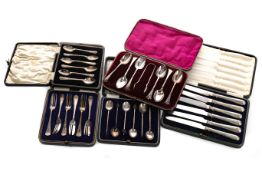 A CASED SET OF SIX SILVER HANDLED KNIVES, A SET OF PASTRY FORKS AND THREE SETS OF SPOONS