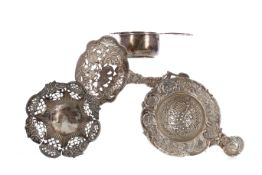 A LOT OF THREE SILVER TEA STRAINERS, AND A BONBON DISH