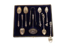 A CASED COMPOSITE SET OF APOSTLE SPOONS AND TONGS