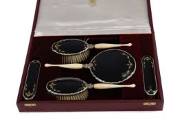 A CASED GEORGE V SILVER AND ENAMEL DRESSING TABLE SET