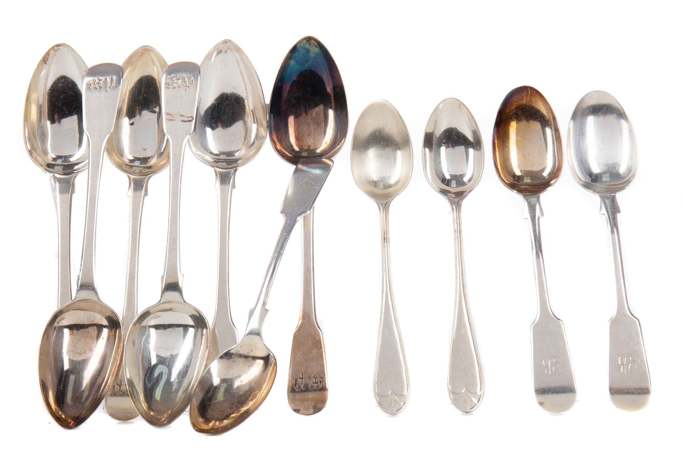 A SET OF SIX GEORGE III TEASPOONS ALONG WITH OTHER SILVER SPOONS