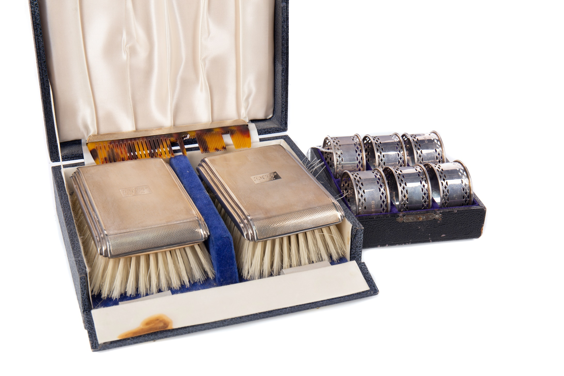 AN ELIZABETH II SILVER BACKED BRUSH SET, ALONG WITH A SET OF NAPKIN RINGS AND TEASPOONS