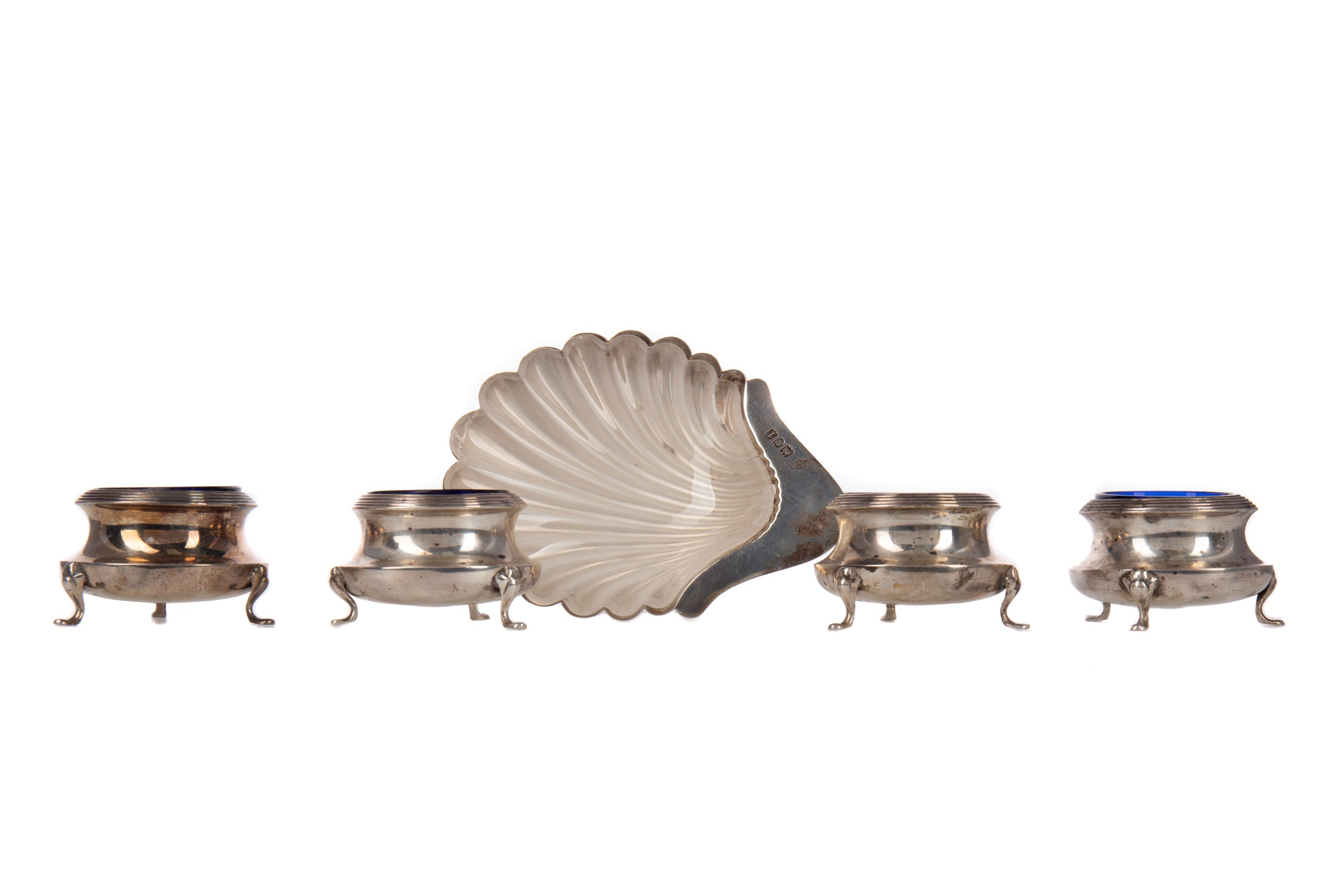 AN EDWARDIAN SILVER BUTTER DISH, ALONG WITH FOUR OPEN SALTS