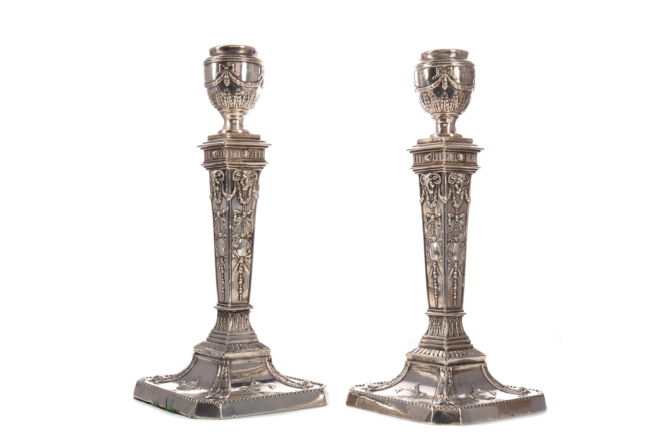 A PAIR OF LATE VICTORIAN SILVER PLATED CANDLESTICKS