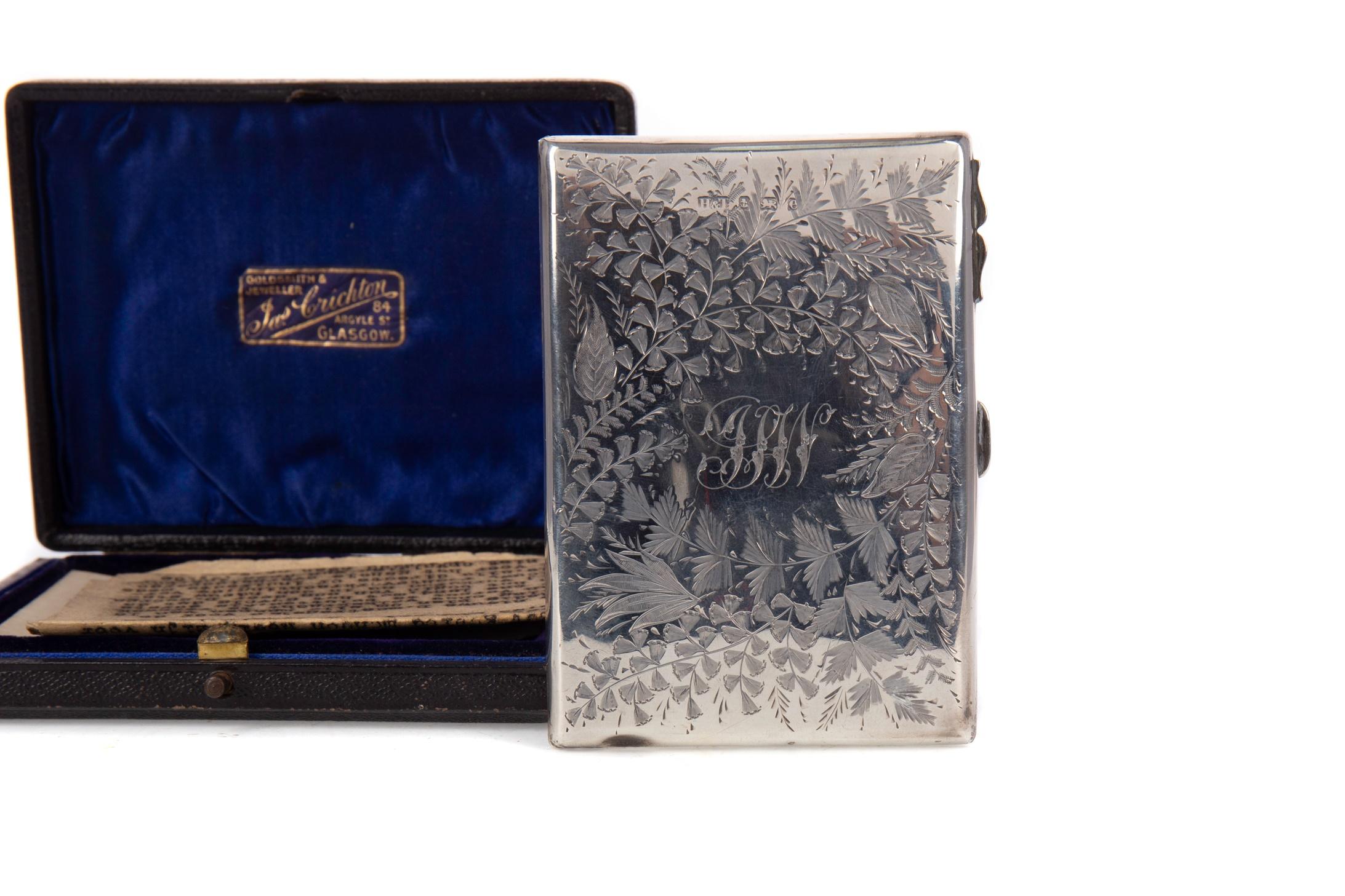 AN EDWARDIAN SILVER CARD CASE