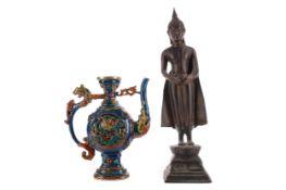 AN EASTERN BRONZE FIGURE OF A STANDING BUDDHA AND A WINE POT