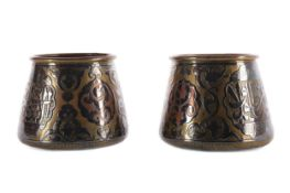 A PAIR OF EASTERN BRASS, COPPER AND SILVER INLAID FERN POTS