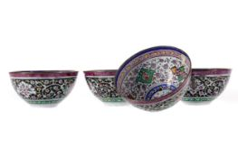 A SET OF FOUR MIDDLE EASTERN ENAMELLED BOWLS