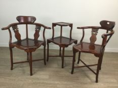 A PAIR OF CHINESE HARDWOOD CORNER CHAIRS AND A TWO TIER TABLE