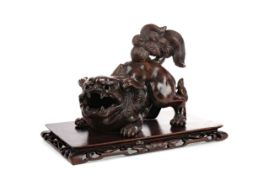 A 20TH CENTURY CHINESE BRONZED POTTERY FOE DOG