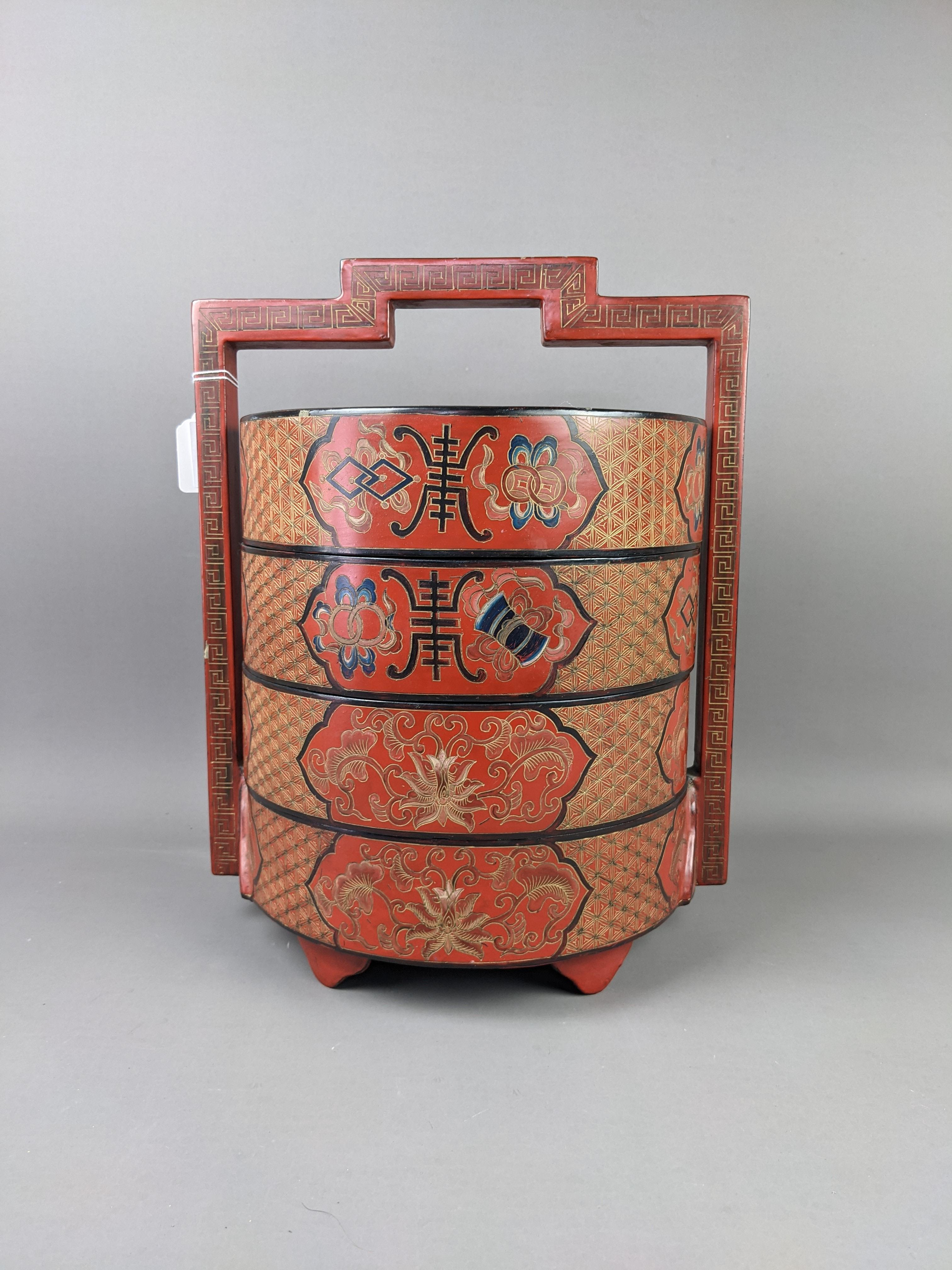 A CHINESE LACQUERED CYLINDRICAL PICNIC BOX