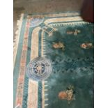 A FINE FRINGED CHINESE CARPET