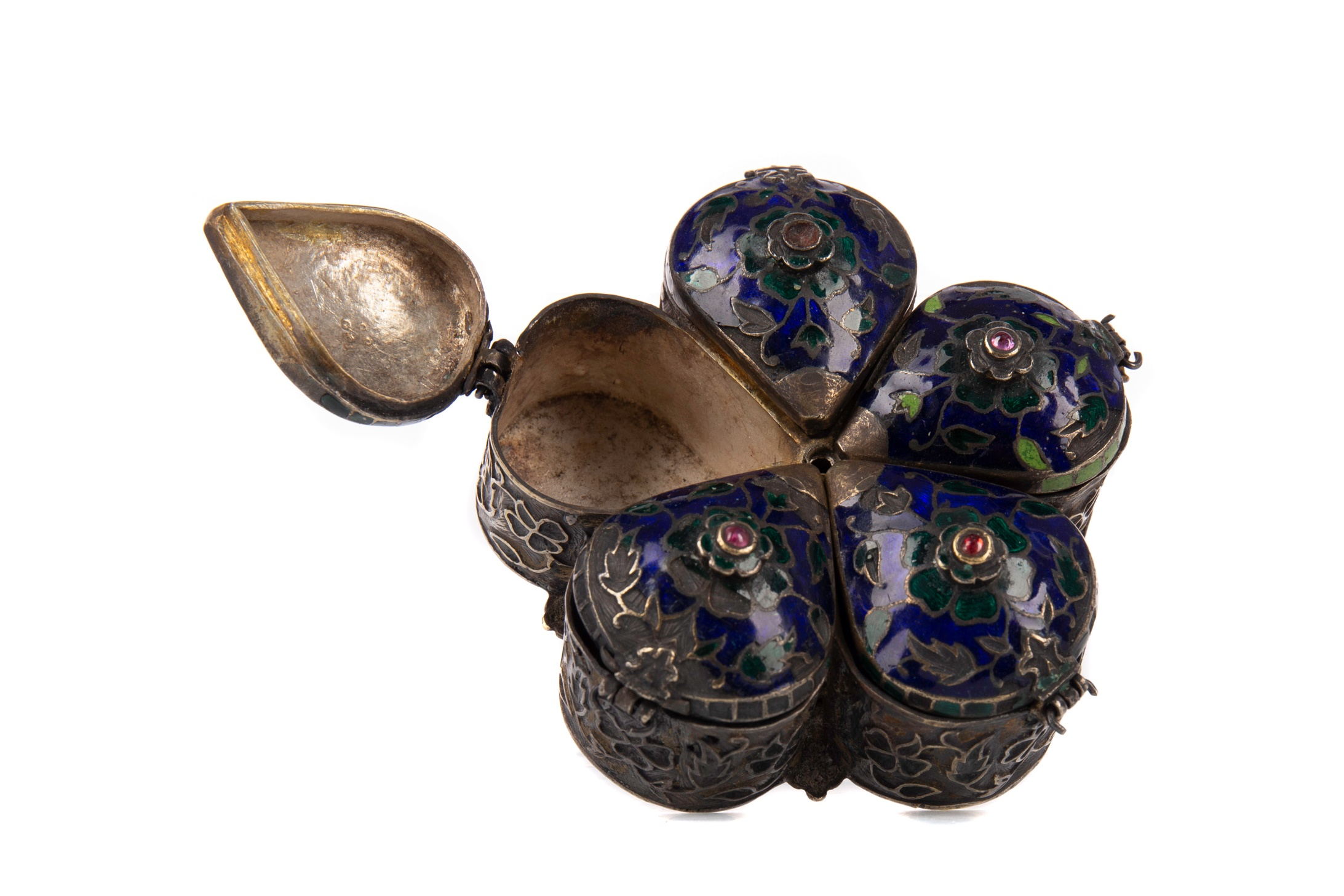AN EARLY 20TH CENTURY MIDDLE-EASTERN WHITE METAL AND ENAMEL SPICE BOX