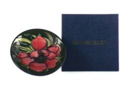 A MOORCROFT 'ANEMONE TRIBUTE' PLATE