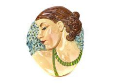 AN ART DECO WALL MASK MODELLED AS A FEMALE HEAD IN PROFILE
