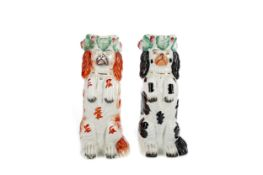 A NEAR PAIR OF MID-19TH CENTURY STAFFORDSHIRE BEGGING DOG JUGS