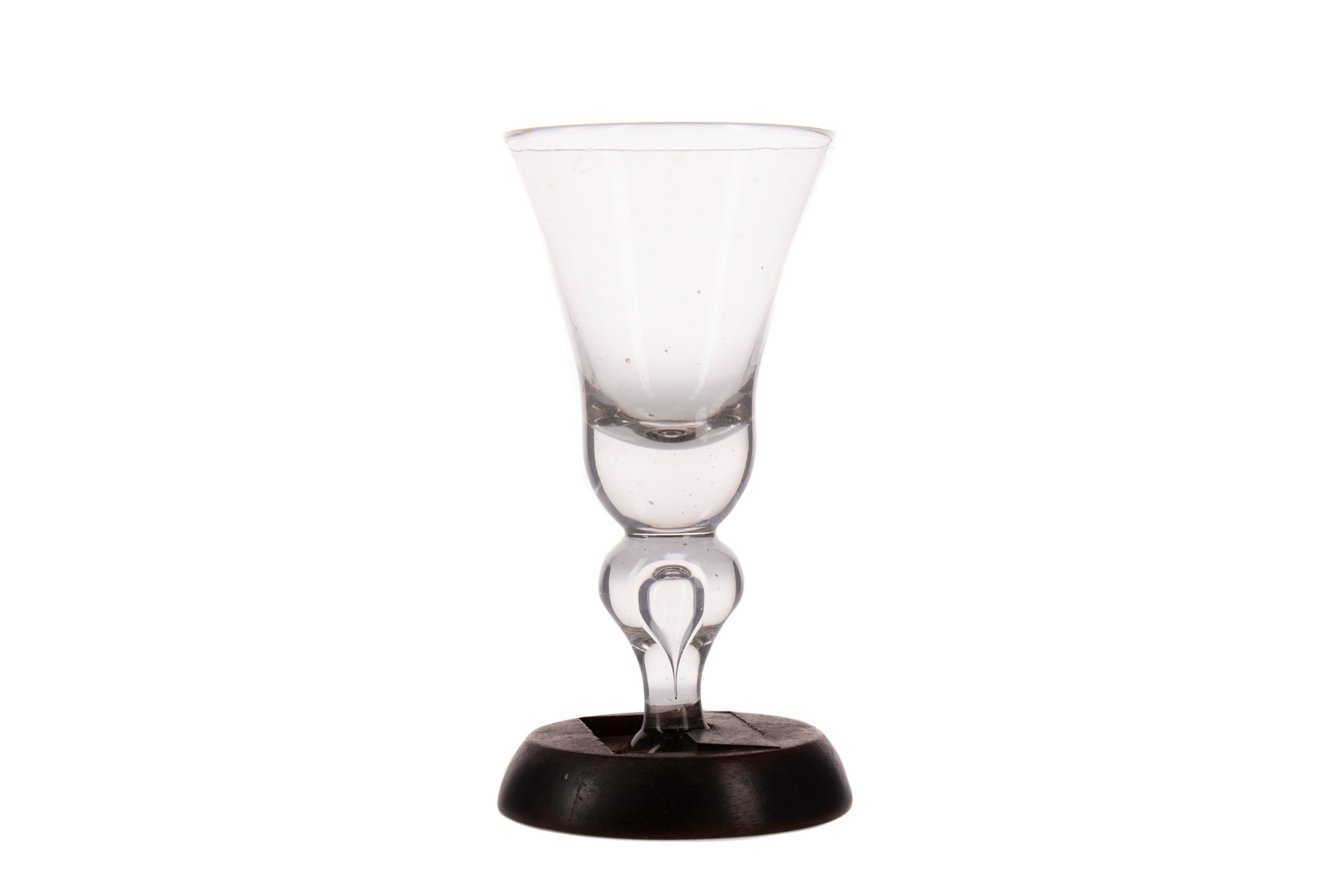 AN EARLY 18TH CENTURY NEWCASTLE HEAVY BALUSTER WINE GLASS