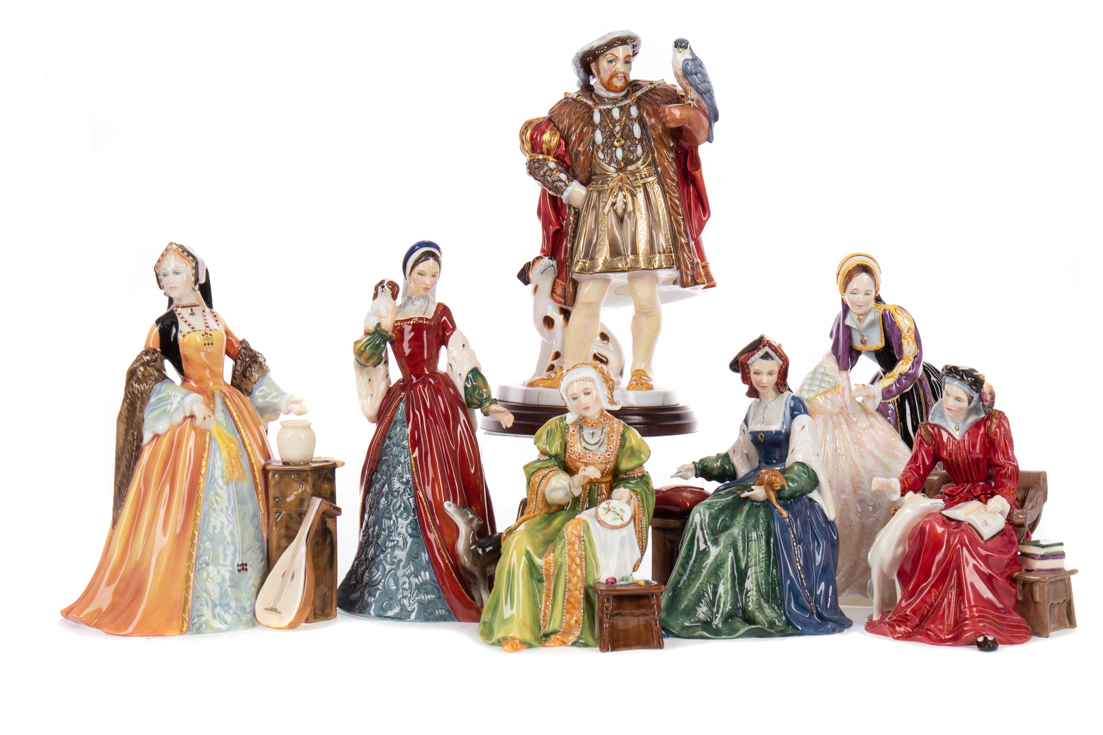 A SET OF ROYAL DOULTON FIGURES COMPRISING HENRY VIII AND HIS SIX WIVES