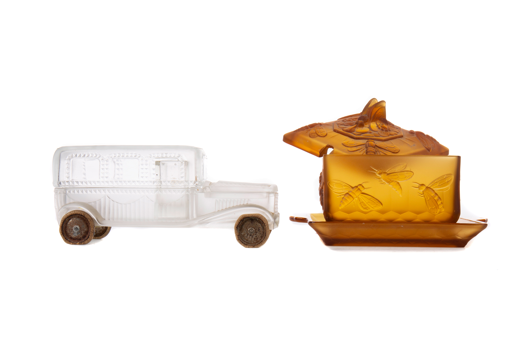 AN EARLY 20TH CENTURY AMBER GLASS PRESERVE JAR, COVER AND STAND, ALONG WITH A FROSTED GLASS JAR