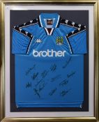 A SIGNED FRAMED MANCHESTER CITY F.C. JERSEY