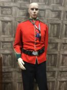 A MODERN MANNEQUIN IN MILITARY DRESS AND ANOTHER