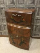 AN EARLY 20TH CENTURY JAPANNED WALNUT COCKTAIL CABINET