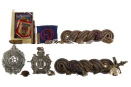 A KING'S OWN SCOTTISH BORDERERS CAP BADGE ALONG WITH ANOTHER CAP BADGE AND BUTTONS