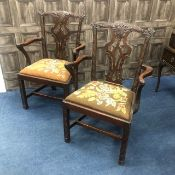 A SET OF FOUR MAHOGANY OPEN ELBOW CHAIRS