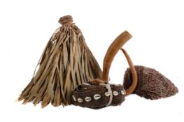A DANI TRIBE PENIS SHEATH ALONG WITH OTHER TRIBAL ITEMS