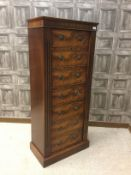 A SHOTGUN CABINET IN THE FORM OF A MAHOGANY WELLINGTON CHEST