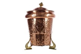 AN ARTS & CRAFTS HAMMERED COPPER COAL BIN AND COVER