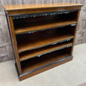 A LATE VICTORIAN MAHOGANY AND EBONISED OPEN BOOKCASE