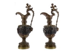 A PAIR OF LATE VICTORIAN RENAISANCE REVIVAL BRONZE EWERS